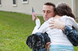 Military father hugging daughter