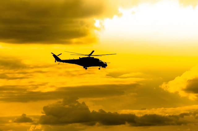 combat helicopters Mi-24 against the sky